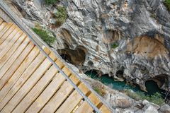 El Caminito del Rey footpath with deep canyon and river. Top view of King`s Little Path footpath across vertical wall with deep canyon and river, one of the most Royalty Free Stock Photos