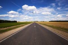 El camino asfaltado fotografía de archivo