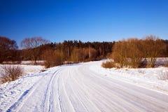 El camino del invierno Imágenes de archivo libres de regalías