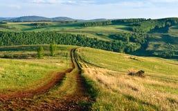 El camino en las colinas Fotos de archivo libres de regalías