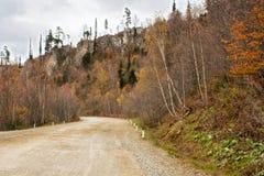 El camino está entre rocas Imagenes de archivo