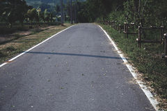 El camino largo del cemento el camino de casa Imagen de archivo libre de regalías