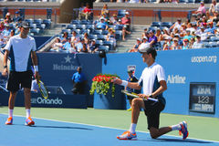 El campeón Mike Bryan del Grand Slam durante los dobles 2014 del semifinal del US Open hace juego en Billie Jean King National Te Imagenes de archivo