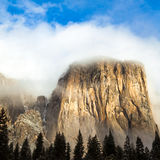 El Capitan. Shrouded by cloudes in Yosemite National Park, California Stock Photography