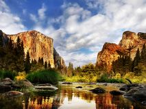 Yosemite Valley, National Park, El Capitan. El Capitan and the Cathedral Rocks reflection in Merced River. Yosemite Valley. Yosemite National Park Royalty Free Stock Photos