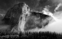 El Capitan at dawn. Black and White Photograph of El Capitan in Yosemite National Park, California. Taken just after dawn with dramatic mist and side lighting stock photo