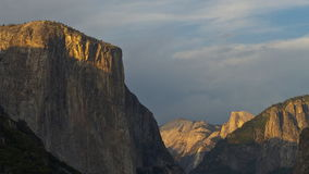 El capitan and half dome time lapse. A time lapse shot of the sun setting on half dome and el capitan at yosemite recorded from tunnel view stock video