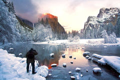 El Capitan at Sundown. A photographer capturing a picture of El Capitan at sunset royalty free stock images