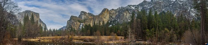 El Capitan and Three Brothers Mountains Panorama. Panorama of El Capitan mountain in the left and the Three Brothers peak seen from the distance in Yosemite Royalty Free Stock Images