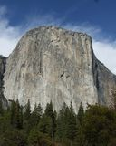 El Capitan, Yosemite national park, America. Blue sky, white clouds, green trees royalty free stock photography