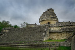 The `El Caracol` observatory temple in Chichen Itza complex. El Caracol `The Snail` is located to the north of Las Monjas. It is a round building on a large royalty free stock photo