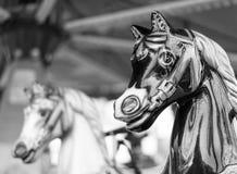El carrusel o felices va los caballos de la ronda Imagen de archivo libre de regalías