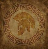 El casco espartano un icono en el papel viejo en grunge del estilo, se publica en estilo griego antiguo Fotos de archivo libres de regalías