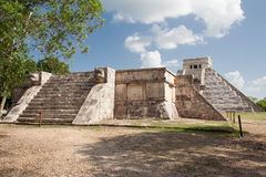 El Castillo Chichen Itza Mexico. The imposing geometric El Castillo pyramid devoted to Kukulcan god with its stairs and the Venus Platform with its serpent heads Stock Photo