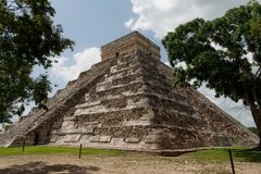 El Castillo Chichen Itza Mexico. The imposing geometric pyramidal structure of the main temple of the maya archaeological site of Chichen Itza, El Castillo with Royalty Free Stock Images