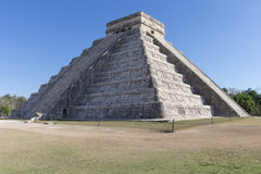El Castillo pyramid at Chichen Itza with blue sky. Famous El Castillo Temple of Kukulkan at Maya ruins of Chichen Itza with shadow of serpent along staircase Stock Image