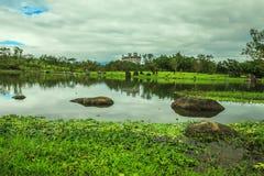El castillo solo con el lago Imagen de archivo libre de regalías
