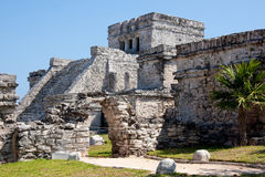 El Castillo Temple at Tulum. Tulum is one of the best-preserved coastal Maya sites and a popular site for tourists. El Castillo (the castle), a temple with two stock photo