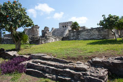 El Castillo Temple at Tulum. Tulum is one of the best-preserved coastal Maya sites and a popular site for tourists. El Castillo (the castle), a temple with two royalty free stock photos