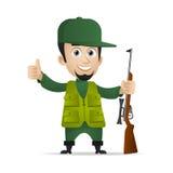 El cazador sostiene la escopeta y el mostrar los pulgares para arriba Fotos de archivo libres de regalías