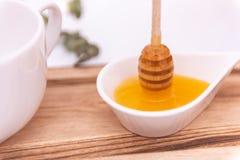 El cazo de la miel y un blanco pueden imagen de archivo