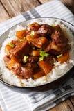 El cerdo Hamonado es un plato filipino que implica el cocinar de la carne Imagenes de archivo