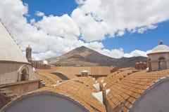 El Cerro Rico Mountain. Raising over the colonial roofs of Potosi, Bolivia royalty free stock photos