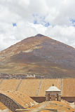 El Cerro Rico Mountain. Raising over the colonial roofs of Potosi, Bolivia Stock Images