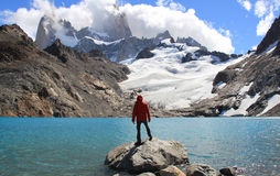 El Chalten (Argentina's Trekking Capital) - Patagonia. Man, blue lake, glacier and mountains. El Chalten (Argentina's Trekking Capital) - Patagonia Stock Photo