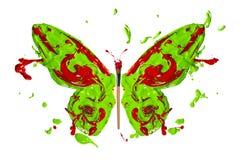 El chapoteo rojo verde de la pintura hizo la mariposa Foto de archivo