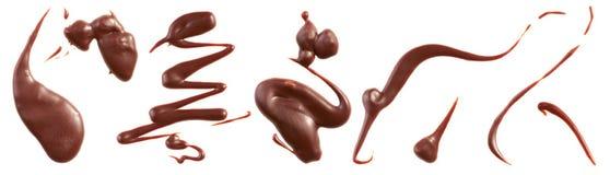 El chocolate con leche salpica Fotos de archivo