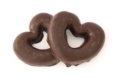 El chocolate cubrió corazones del pan de jengibre Imagen de archivo
