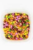 El chocolate cubrió los caramelos de los gérmenes del suflower Imágenes de archivo libres de regalías