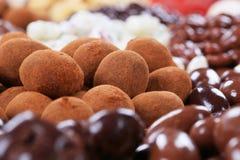 El chocolate cubrió tuercas Imagen de archivo libre de regalías