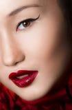 El cierre asiático de la mujer para arriba con encanto compone y rojo Fotografía de archivo libre de regalías