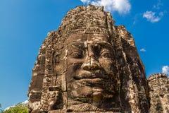 El cierre para arriba del Buddah de piedra hace frente en Siem Reap, Camboya Fotos de archivo libres de regalías