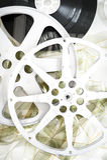 El cine de la película aspa en vertical desenrollada 35 milímetros de la película Foto de archivo libre de regalías