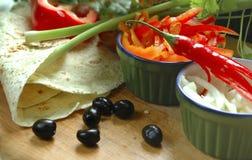 El cocinar con los chiles rojos Imagen de archivo libre de regalías
