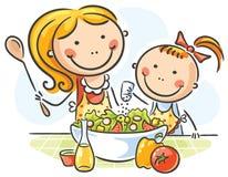 El cocinar de la madre y de la hija Imagen de archivo libre de regalías