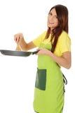 El cocinar de la mujer joven Foto de archivo