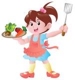 El cocinar de la niña Foto de archivo