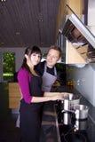 El cocinar de los pares Foto de archivo libre de regalías