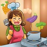 El cocinar del amor de la mama Imagenes de archivo