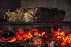 el cocinar del filete del T-hueso Imagenes de archivo