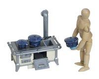 El cocinar en estufa retra con los potes manchados Imagen de archivo