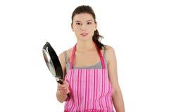 El cocinar enojado de la mujer joven Fotografía de archivo libre de regalías