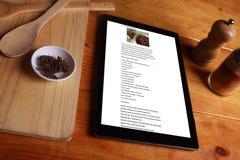 El cocinar y concepto aislados en fondo de madera Fotografía de archivo libre de regalías