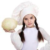 El cocinar y concepto de la gente - niña sonriente en sombrero del cocinero Fotografía de archivo libre de regalías