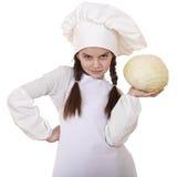 El cocinar y concepto de la gente - niña sonriente en sombrero del cocinero Foto de archivo