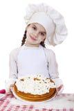 El cocinar y concepto de la gente - niña sonriente en sombrero del cocinero Fotos de archivo libres de regalías
